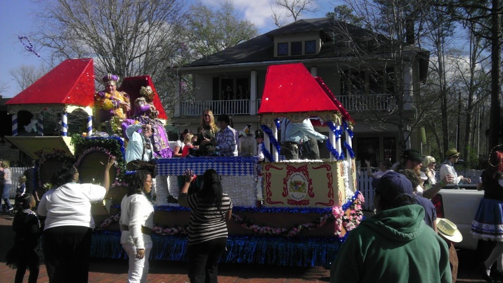 2012 Mardi Gras parade passes the Black Swan