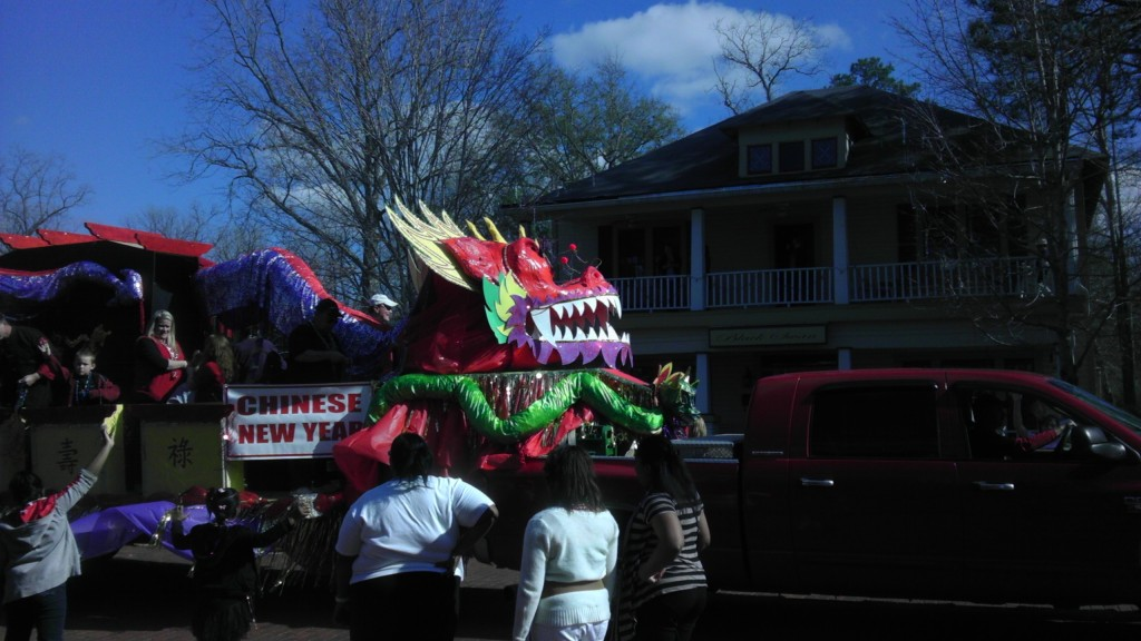 Mardi Gras parade passes the historic Black Swan